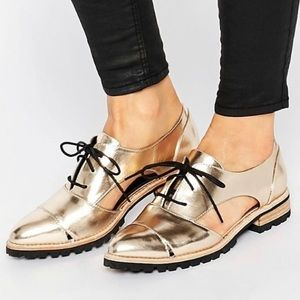 Gold cutout loafers